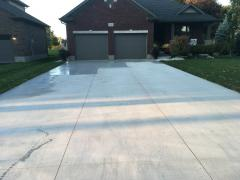 Lane way all finished, applying sealant to protect the concrete's  finish.