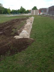 Natural stone retaining wall for garden.