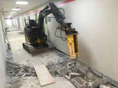 Concrete breaking inside building and dig down to sewer lines to add washroom in each room.