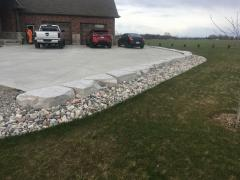 Small retaining wall armour stone for border to driveway.