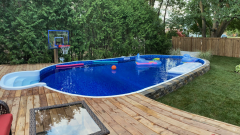 On - Ground pool installation, completed and landscaped.