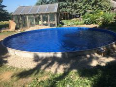 24' Round on ground pool filled with water ready for building deck.