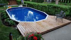 The 12' by 24' after customer finished deck and landscaping.